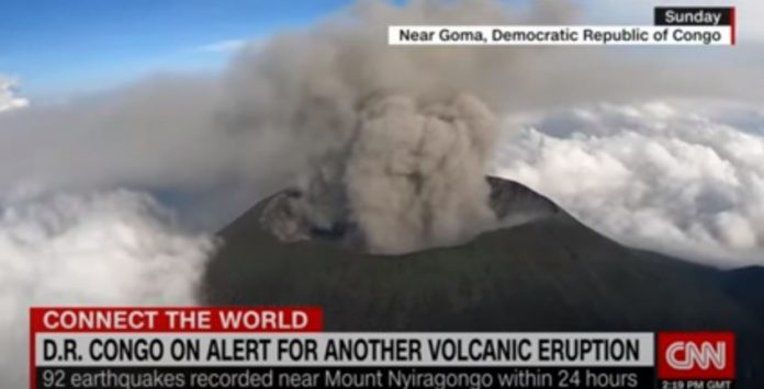 Remarkable aerial video shows volcano spewing ash