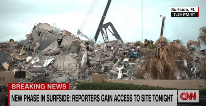 New images show up-close view of collapsed building site