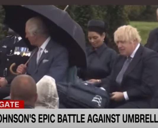 Boris Johnson's umbrella struggle makes Prince Charles laugh