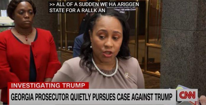 Georgia prosecutor quietly pursues case against Trump